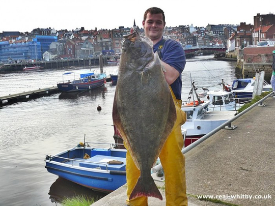 Richard Cope with a 56lb Halibut caught last April, just 12oz short of the port record.